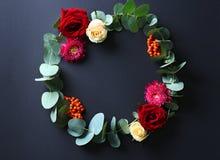 Beautiful flowers wreath. On dark grey background stock photos