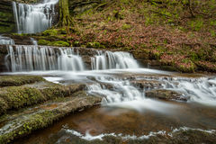 Beautiful Flowing Waterfall With Cascades In Woodland Environment. Stock Photography