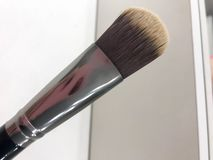 Beautiful fluffy brush for applying makeup, powder, eye shadow stock photos