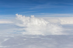 Beautiful fluffy white cumulus clouds on blue sky background. Stock Photography
