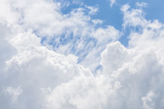 Beautiful fluffy white cumulus clouds on blue sky background. Royalty Free Stock Photography