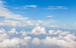 Beautiful fluffy white cumulus clouds in sunny blue sky. Stock Photos