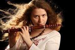 Beautiful Flutist Stock Image