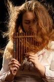 Beautiful Flutist Royalty Free Stock Photography