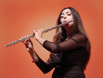 Beautiful Flutist. Beautiful girl playing flute at the concert