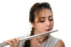 Beautiful Flutist (horizontal). Beautiful woman playing flute Stock Images