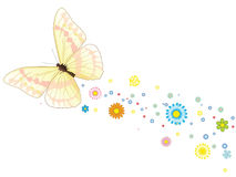 Beautiful flying butterfly with a trace of flowers Royalty Free Stock Photo