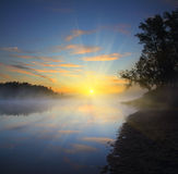 Beautiful fog sunrise on river Stock Photos