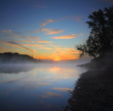 Beautiful fog sunrise on river. Landscape with beautiful fog sunrise on river Stock Image