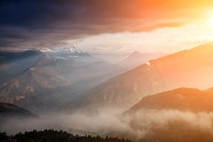 Beautiful foggy dawn in the Himalayas, Nepal Stock Images