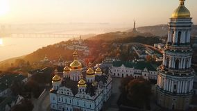 Kiyv Ukrainian capital city. Kiev Pechersk Lavra. Aerial drone video footage. View to rider Dnipro and bridge. Fog and. Beautiful foggy golden morning. Kiyv stock video footage