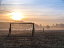 Beautiful foggy soccer pitch. On a field at sunrise Stock Photos