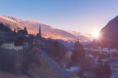 Beautiful foggy sunrise in Alps, alpine ski resort Heiligenblut on the Grossglockner road, Austria stock photography