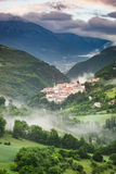 Beautiful foggy sunrise over the village of Preci in Umbria Royalty Free Stock Images