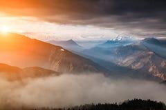 Beautiful foggy dawn in the Himalayas, Nepal Stock Photos