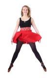 Beautiful folk dancer jumping Stock Images