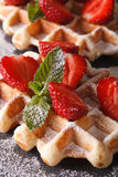 Beautiful food: Belgian waffles with fresh strawberries. vertica Royalty Free Stock Photography