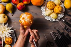 Chinese fruit carving, flat lay hands do it stock photos