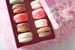 Beautiful food: French macaroons in a gift box close-up on a tab Royalty Free Stock Images