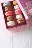 Beautiful food: French macaroons in a gift box close-up on a tab royalty free stock image