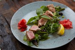 Beautiful food: steak tuna in sesame, lime and fresh salad close-up on a plate on the table. stock photography