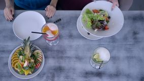 Beautiful food, top view people having dinner and serving fresh salad at table with fruit beverages during the diet