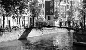 Beautiful foot over bridge on a canal, Amsterdam. stock images