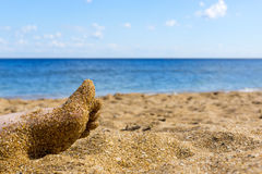 Beautiful foot on sea beach Royalty Free Stock Image