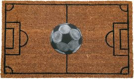 Beautiful football goal field peach color coir doormat with football. Isolated on a White Background stock image