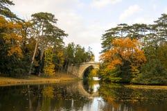 Beautiful forest, bridge and lake at Laxenburg palace, Austria. Beautiful  forest, bridge and lake  Laxenburg palace , Austria during autumn season Stock Image