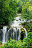 Beautiful forest cascade waterfall with clear, spring river wate Royalty Free Stock Photo