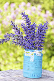 Beautiful forest  flowers in blue vase with white ribbon Royalty Free Stock Photos