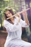 Beautiful forest nymph with a flute Royalty Free Stock Image