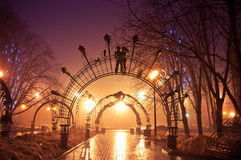 Beautiful forged figures park in the night Royalty Free Stock Photos