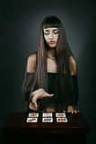 Beautiful fortune teller with tarot cards. Mistery and cartomancy Royalty Free Stock Photography