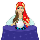 Beautiful fortune teller woman reading future on magical crystal ball Royalty Free Stock Photography