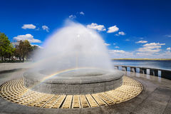 Beautiful fountain against the blue sky with clouds Stock Photos