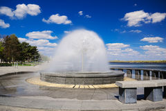 Beautiful fountain against the blue sky with clouds V Royalty Free Stock Photography