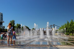 A beautiful fountain and citizens in a city park Museon. Stock Images
