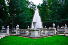A beautiful fountain with decorative fence. Highest fountain surrounded by a decorative stone wall of white. The fountain is located in a green Park with lush stock images
