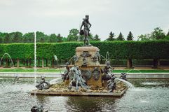 Beautiful fountain with figures in the Upper Garden of Peterhof in St. Petersburg. close royalty free stock images