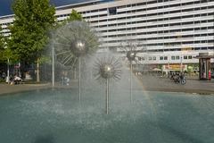 A beautiful fountain in the form of a ball on the square in the old town Royalty Free Stock Photography
