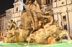 Beautiful Fountain of the Four Rivers by night on Piazza Navona in Rome, Italy Stock Image