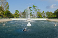 Beautiful fountain in lake with blue sky Royalty Free Stock Image