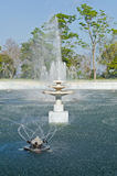 Beautiful fountain in lake with blue sky Royalty Free Stock Photo