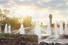 Beautiful fountain with many splashes and sun Stock Photo