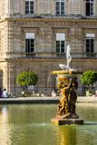 Fountain near the Luxembourg Palace in the Luxembourg Gardens. P. Beautiful fountain near the Luxembourg Palace in the summer at sunset. It is the seat of French Stock Photography