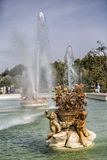 Beautiful fountain near the Royal Palace of Aranjuez, Spain. Aranjuez, Spain - October 16, 2016: Beautiful fountain near the Royal Palace of Aranjuez,  located Royalty Free Stock Photo