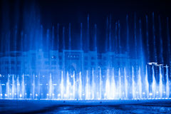 Beautiful fountain at night illuminated with blue light Stock Photography