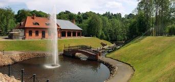 Beautiful fountain in park at the openwork bridge. Belmontas park. Lithuania Stock Photo